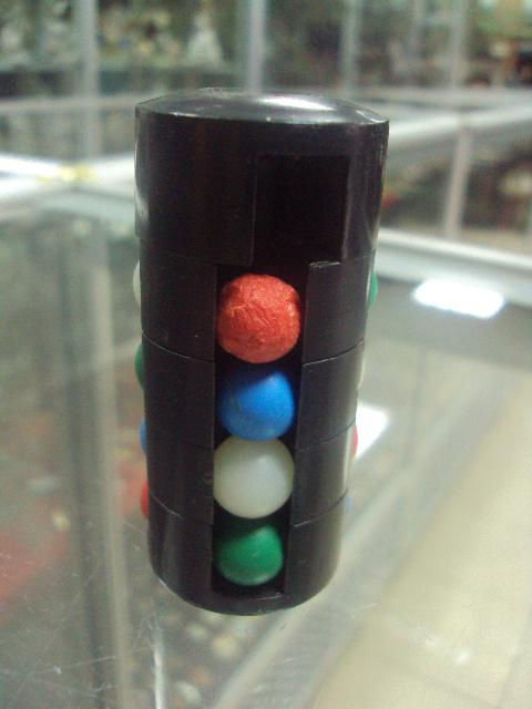 игрушка цилиндр рубика