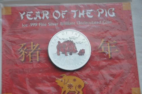 """5 доларів Соломонових островів """"Рік свині"""" 2007 року,срібло."""