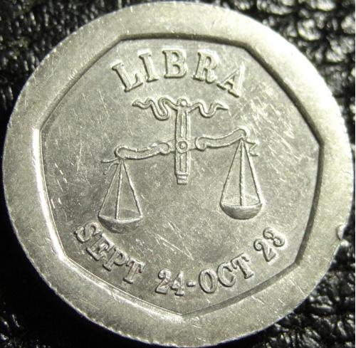 10 пенсів транспортний жетон 1994 Британія Терези