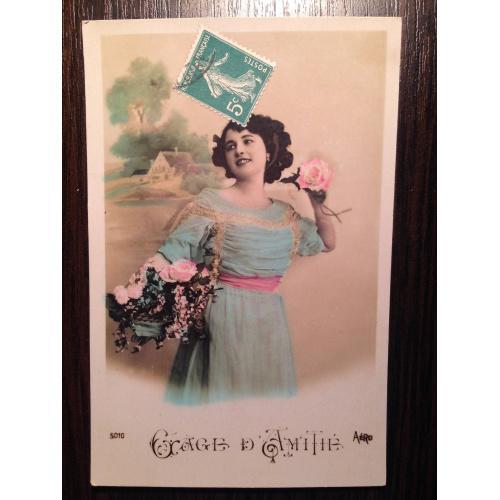 Французская фотооткрытка. Девушка в бирюзовом платье с корзиной цветов. 1910 г.