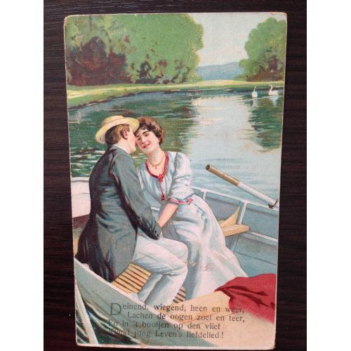 Старинная открытка. Мужчина и женщина в лодке.