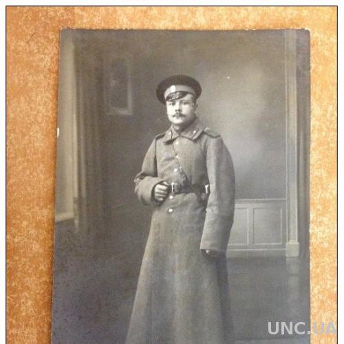 Старинная открытка Фото. Первая мировая война. Солдат в зимней шинели