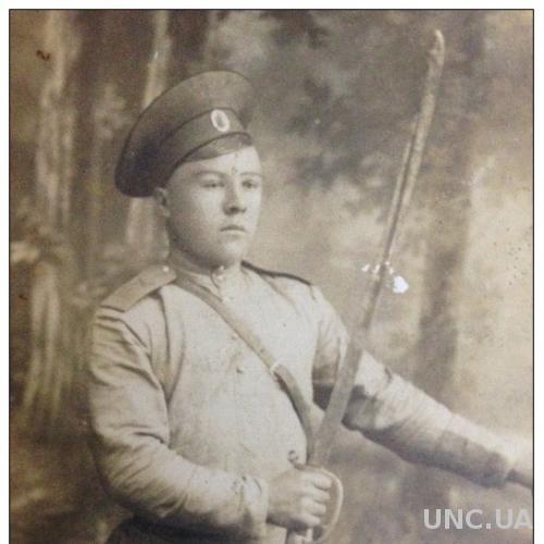 Открытка старинная Фотография молодого солдата с саблей Первая мировая война
