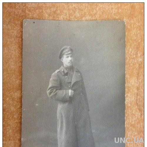Открытка старинная  Первая мировая война. Военный в зимней форме