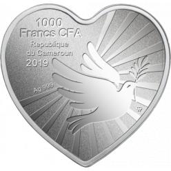 Польша представила монету с изображением ангела и младенца
