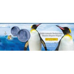 В Англии отчеканили голубую титановую монету с изображением пингвина