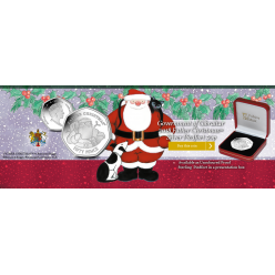 Pobjoy Mint отчеканил рождественские монеты, на которых изображен Дед Мороз